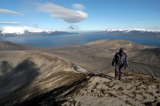 Gary hikes up a slope of volcanic scree, Deception Island