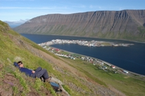 Gary relaxes on a hillside above Isafjordur