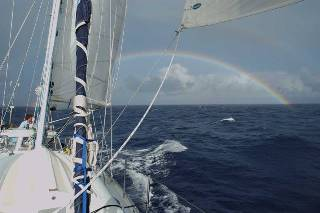 sailing away from a rainbow